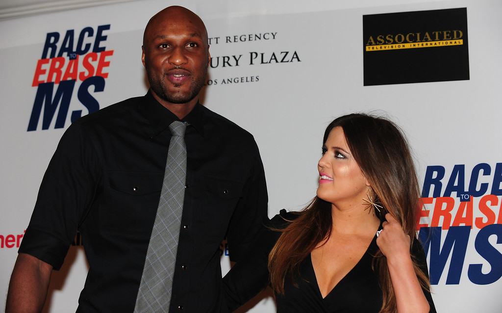". Lamar Odom and Khloe Kardashian-Odom pose on arrival for the 19th Annual Race to Erase MS themed ""Glam Rock to Erase MS\"" in Los Angeles on May 18, 2012.  (FREDERIC J. BROWN/AFP/GettyImages)"