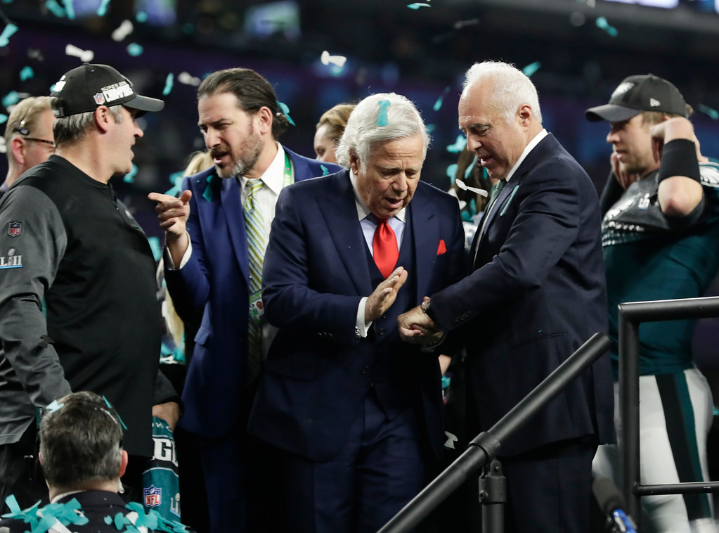 . New England Patriots owner Robert Kraft, left, congratulates Philadelphia Eagles owner Jeffrey Lurie after the Eagles won the NFL Super Bowl 52 football game against the New England Patriots, Sunday, Feb. 4, 2018, in Minneapolis. The Eagles won 41-33. (AP Photo/Frank Franklin II)