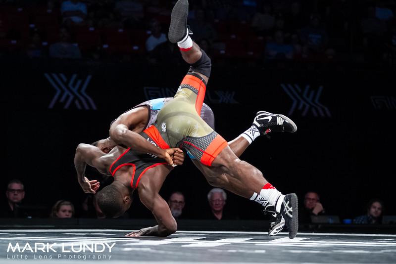 Match 1: Mango tech. fall Johnson, 13-2