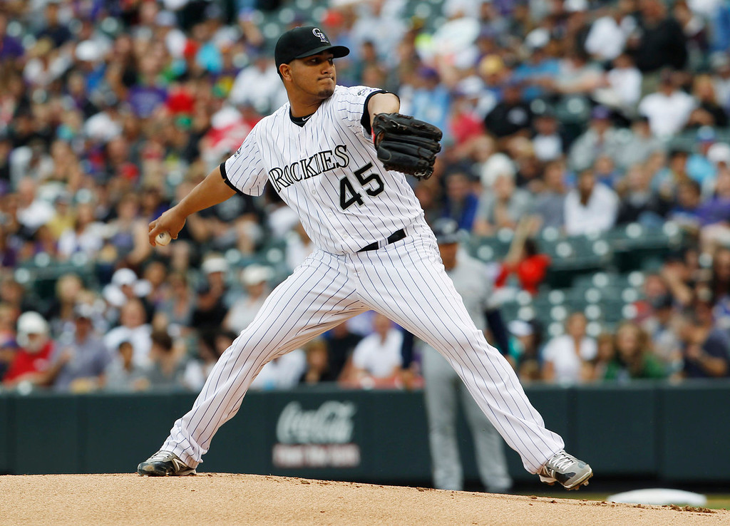 . Colorado Rockies starting pitcher Jhoulys Chacin works against the Milwaukee Brewers in the first inning of a baseball game in Denver on Sunday, July 28, 2013. (AP Photo/David Zalubowski)