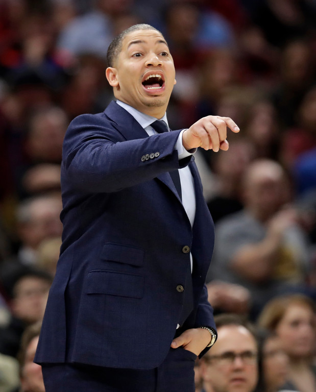 . Cleveland Cavaliers head coach Tyronn Lue yells instructions to players in the first half of an NBA basketball game against the Philadelphia 76ers, Thursday, March 1, 2018, in Cleveland. (AP Photo/Tony Dejak)