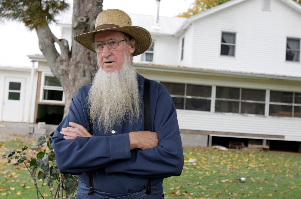Description of . In this Monday, Oct. 10, 2011 photo, Sam Mullet stands in front of his Bergholz, Ohio, home. Attorneys for a group of Amish men and women found guilty of hate crimes for cutting the hair and beards of fellow members of their faith in eastern Ohio are arguing that the group\'s conviction, sentencing and imprisonment in separate facilities across the country violates their constitutional rights and amounts to cruel and unusual punishment, according to recent court filings. The Amish group\'s leader, Mullet, was sentenced to 15 years in prison, while the rest of the group got sentences ranging from one to seven years. (AP Photo/Amy Sancetta, File)