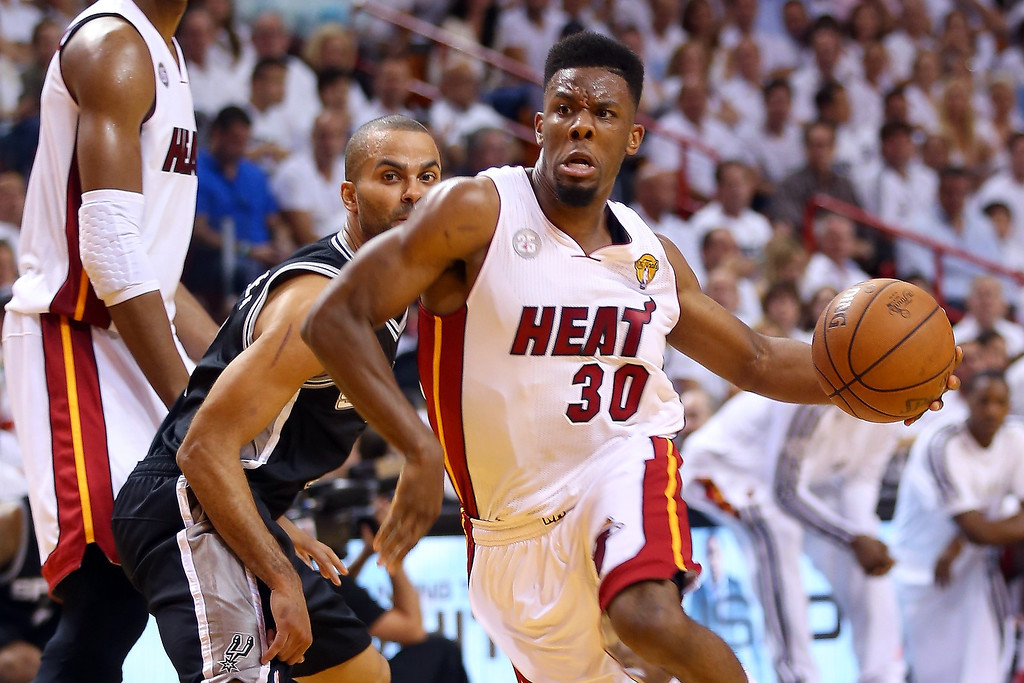 . Norris Cole #30 of the Miami Heat drives on Tony Parker #9 of the San Antonio Spurs in the second quarter during Game One of the 2013 NBA Finals at AmericanAirlines Arena on June 6, 2013 in Miami, Florida. (Photo by Mike Ehrmann/Getty Images)