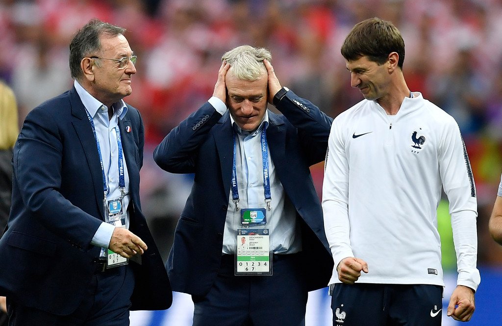. France head coach Didier Deschamps, center, holds his heads after his team won 4-2 during the final match between France and Croatia at the 2018 soccer World Cup in the Luzhniki Stadium in Moscow, Russia, Sunday, July 15, 2018. (AP Photo/Martin Meissner)