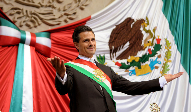 . Mexico\'s new President Enrique Pena Nieto gestures after taking oath in congress in Mexico City December 1, 2012. Enrique Pena Nieto took over as Mexican president on Saturday, offering a shot at redemption for the party that shaped modern Mexico if he can bring an end to years of violence and economic underperformance  REUTERS/Presidencia de Mexico/Handout