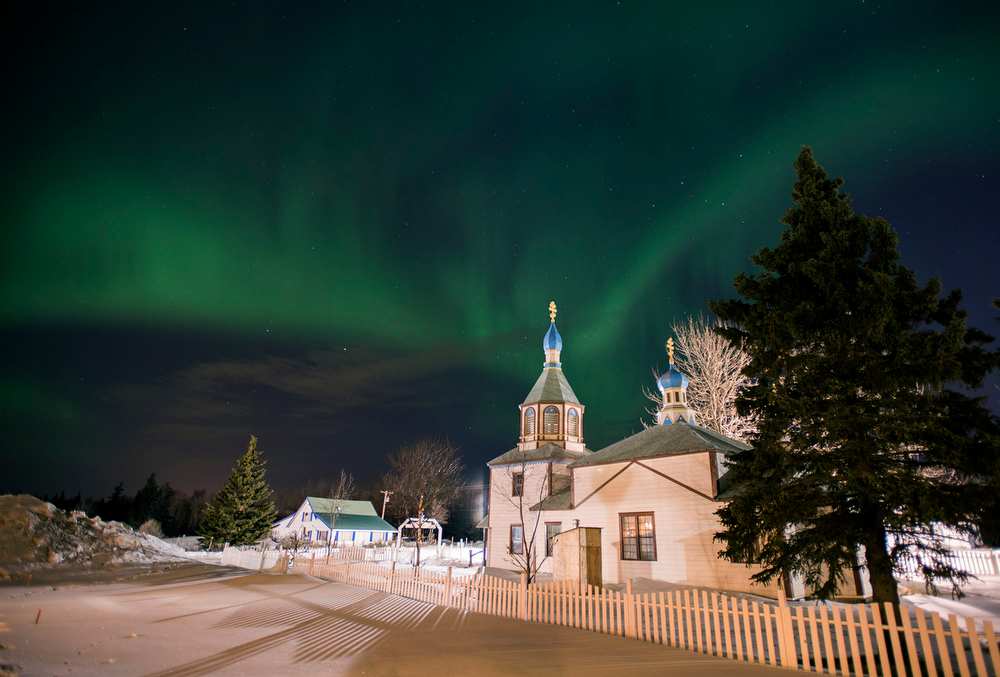 . The aurora borealis, or northern lights, fill the sky early Sunday, March 17, 2013, above the Holy Assumption of the Virgin Mary Russian Orthodox church in Kenai, Alaska. The bright display at times filled the sky. (AP Photo/M. Scott Moon)
