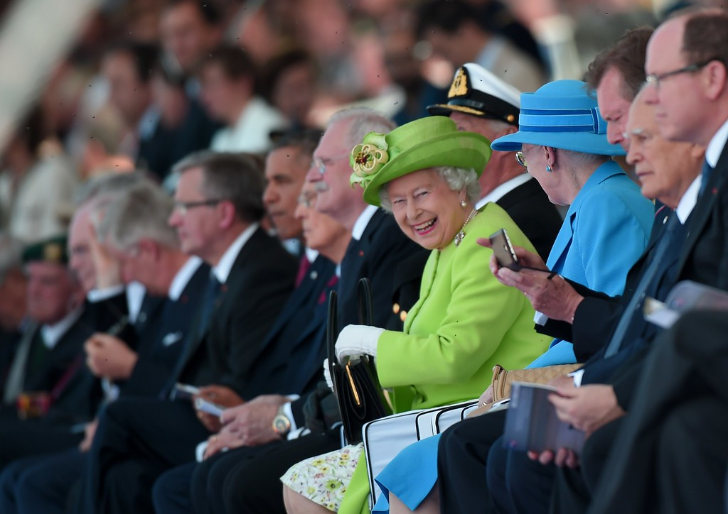 . Britain\'s Queen Elizabeth II (c) smiles next to Danish Queen Margrethe (R) during the international D-Day commemoration ceremony on the beach of Ouistreham, Normandy, on June 6, 2014, marking the 70th anniversary of the World War II Allied landings in Normandy.   AFP PHOTO / DAMIEN MEYER/AFP/Getty Images