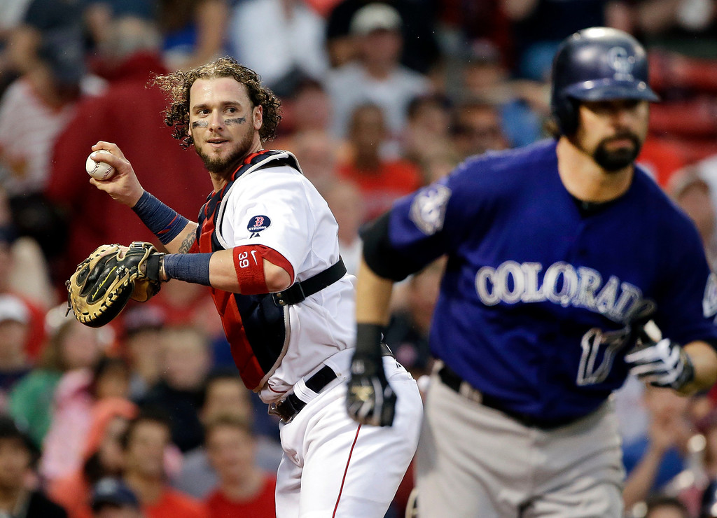 . Boston Red Sox catcher Jarrod Saltalamacchia throws to first to put out Colorado Rockies\' Todd Helton, after a dropped third strike during the eighth inning of an interleague baseball game at Fenway Park in Boston, Wednesday, June 26, 2013. The Red Sox won 5-3. (AP Photo/Elise Amendola)