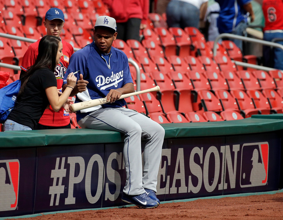 . Los Angeles Dodgers\' Carlos Marmol signs autographs before Game 2 of the National League baseball championship series against the St. Louis Cardinals Saturday, Oct. 12, 2013, in St. Louis. (AP Photo/Chris Carlson)