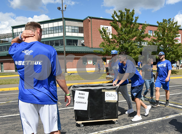 09/08/17 Wesley Bunnell   Staff A Pack the Truck event for Hurricane Harvey relief took place on Friday afternoon in the parking lot at New Britain Stadium. The event was a partnership between the New Britain Bees, Houston Astros outfielder George Springer, Siracusa Moving and Storage, A1 Automotive Repair, the Connecticut Blue Jays AAU Travel Team and Premier Limousine with trucks from Siracusa leaving for Houston following the event. CCSU student athletes volunteered to help unload donations.