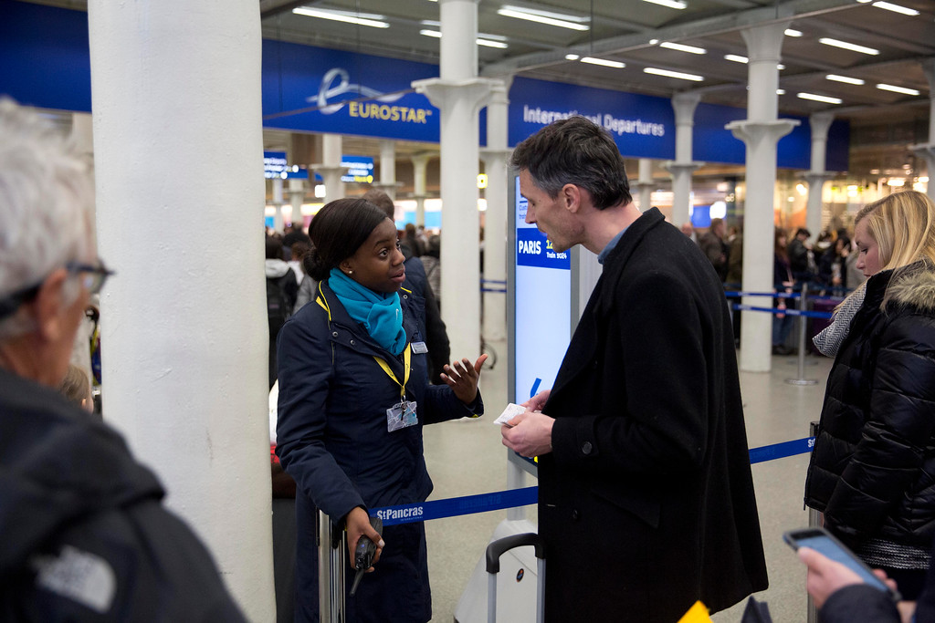. A Eurostar representative gives advice to a traveler after services were suspended on the Brussels Eurostar train route because of the attacks in Belgium, at St Pancras international railway station in London, Tuesday, March 22, 2016. Explosions, at least one likely caused by a suicide bomber, rocked the Brussels airport and subway system Tuesday, prompting a lockdown of the Belgian capital and heightened security across Europe. (AP Photo/Matt Dunham)