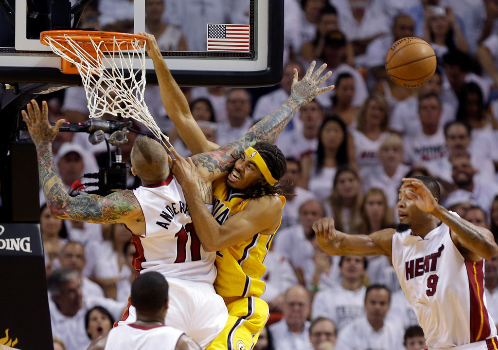 . Miami Heat forward Chris Andersen (11) blocks a shot to the basket by Indiana Pacers forward Chris Copeland (22) during the second half Game 6 in the NBA basketball playoffs Eastern Conference finals on Friday, May 30, 2014, in Miami. Heat forward Rashard Lewis (9) looks on. (AP Photo/Lynne Sladky)