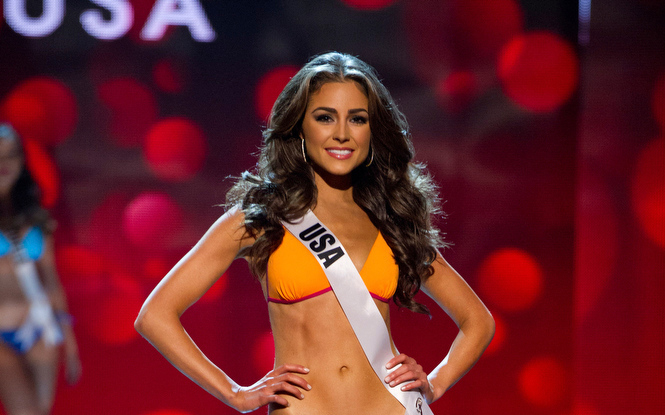 Description of . Miss USA 2012, Olivia Culpo, competes during the Swimsuit Competition of the 2012 Miss Universe Presentation Show on Thursday, Dec. 13, 2012 at PH Live in Las Vegas. The 89 Miss Universe Contestants will compete for the Diamond Nexus Crown on December 19.  (AP Photo/Miss Universe Organization L.P., LLLP)