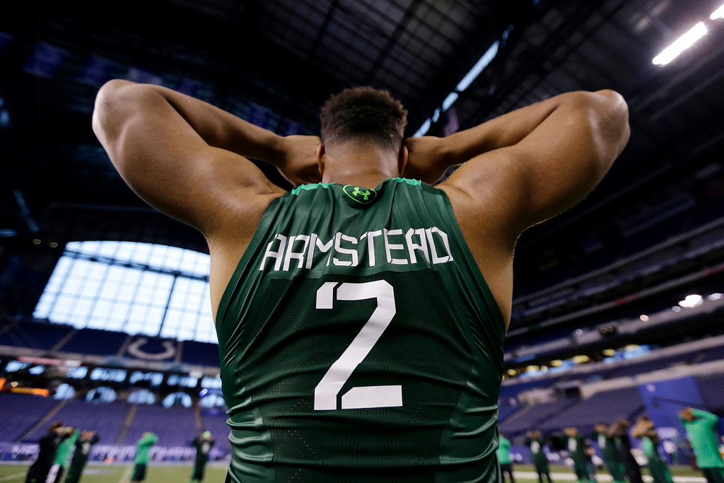 . Orgegon defensive lineman Arik Armstead stretches before drills at the NFL football scouting combine in Indianapolis, Sunday, Feb. 22, 2015. (AP Photo/Julio Cortez)