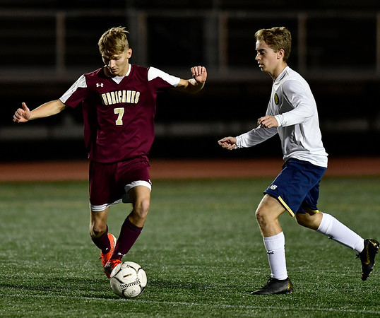 10/24/2019 Mike Orazzi | StaffrNew Britain's Konrad Piechota (7) during Thursday night's boys soccer with Simsbury at Veterans Stadium in New Britain.