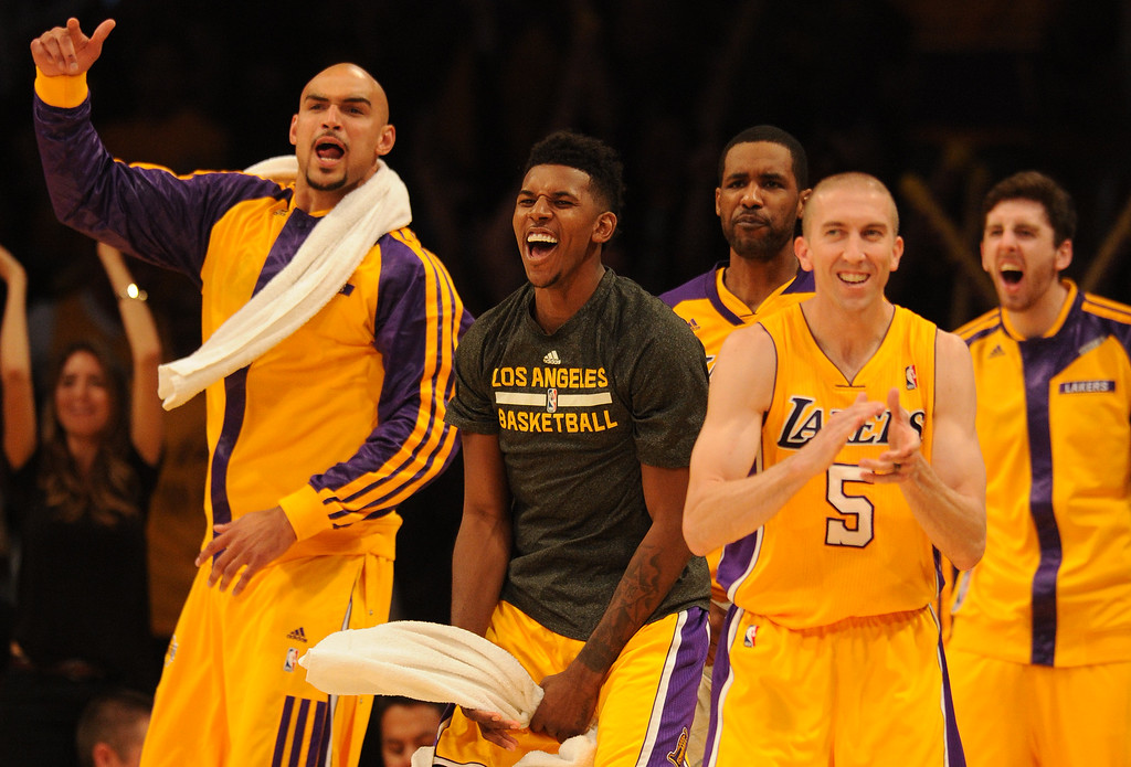 . The Lakers bench celebrates in the 4th quarter. The Los Angeles Lakers defeated the Clippers 116 to 103 in the opening game of the season at Staples Center. Los Angeles, CA. 10/29/2013. photo by (John McCoy/Los Angeles Daily News)