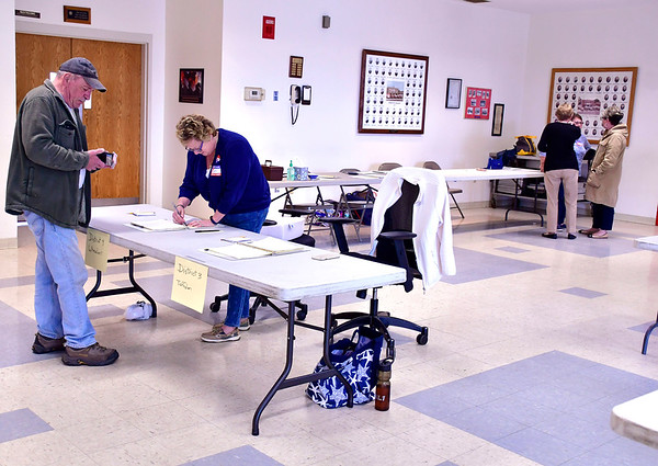 4/30/2019 Mike Orazzi | Staff Voter Bob Beveridge checks in with Debbie Gammon at the Plainville Fire Station during Tuesday's budget vote.