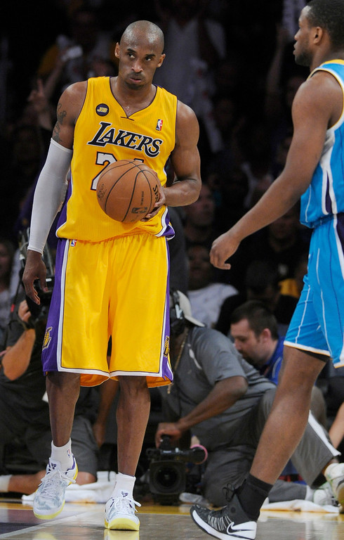 . Kobe Bryant looks releaved after the final horn sounded. The Lakers defeated New Orleans Hornets 104-96 in a game played at Staples Center in Los Angeles, CA 4/9/2013(John McCoy/Staff Photographer