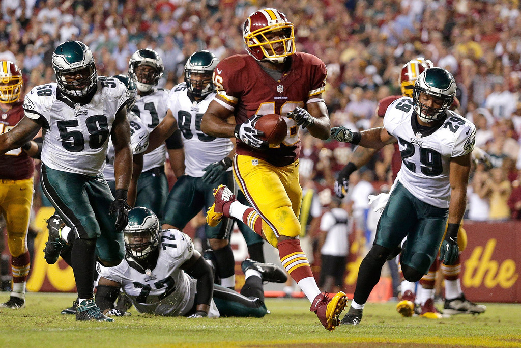 . Washington Redskins running back Alfred Morris carries the ball into the end zone for a touchdown during the second half of an NFL football game against the Philadelphia Eagles in Landover, Md., Monday, Sept. 9, 2013. (AP Photo/Patrick Semansky)