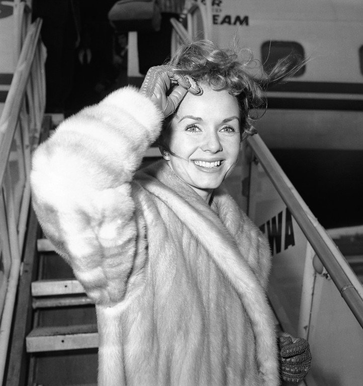 . Screen actress Debbie Reynolds is a pretty wind-blown portrait as she boards airliner on March 6, 1959 in New York for Spain where she will film a new picture.  (AP Photo/John Rooney)