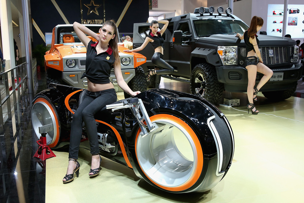 . Models stand beside G.Patton vehicle during the 2014 Beijing International Automotive Exhibition at China International Exhibition Center on April 21, 2014 in Beijing, China. More than 2,000 automotive enterprises from 14 countries and regions participated in the 2014 Beijing International Automotive Exhibition from April 20 to April 29.  (Photo by Feng Li/Getty Images)