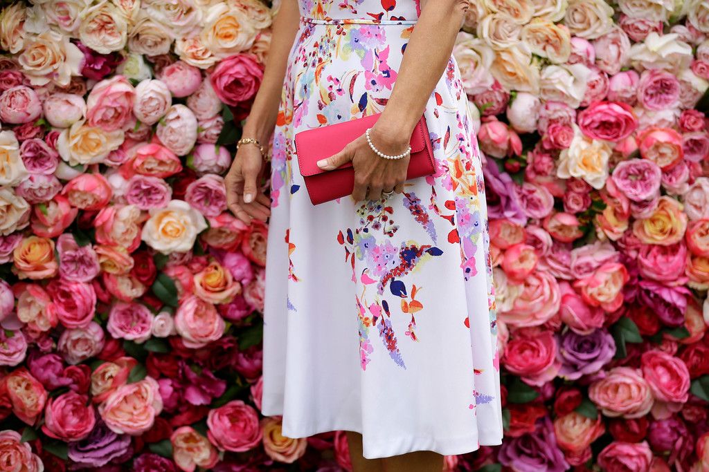 . A racegoer poses for photographers on the first day of the Royal Ascot horse race meeting in Ascot, England, Tuesday, June 19, 2018. (AP Photo/Tim Ireland)