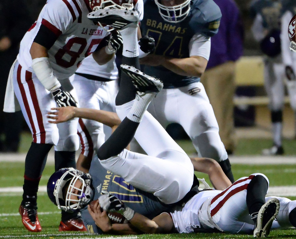 . Diamond Bar\'s Tyler Peterson (C) (14) is tackled by the La Serna defense in the first half of a CIF-SS playoff football game at Diamond Bar High School in Diamond Bar, Calif., on Friday, Nov. 22, 2013.   (Keith Birmingham Pasadena Star-News)