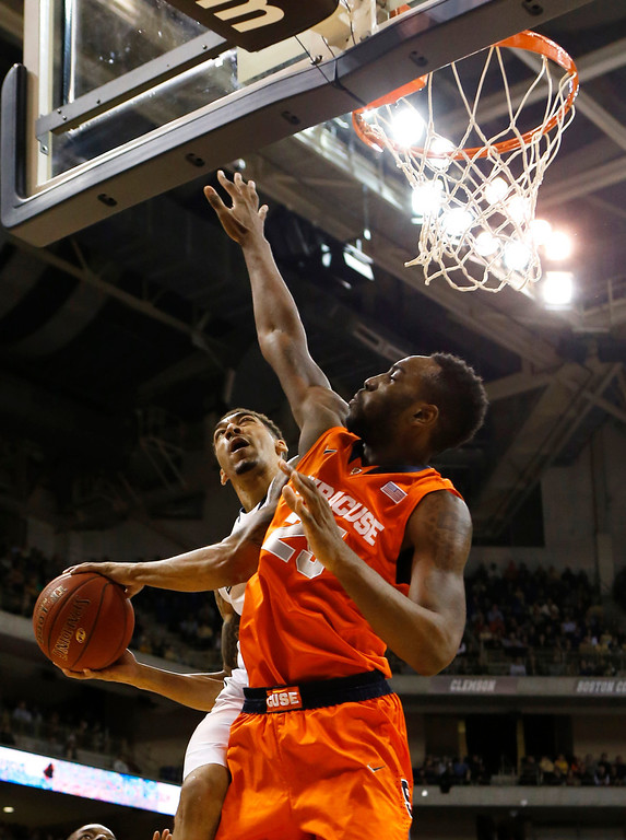 . Pittsburgh\'s Cameron Wright, left, shoots around Syracuse\'s Rakeem Christmas (25)during the first half of an NCAA college basketball game on Wednesday, Feb. 12, 2014, in Pittsburgh. (AP Photo/Keith Srakocic)