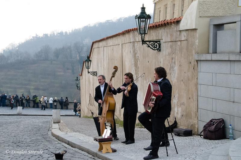 Street musicians perform at Prague Castle