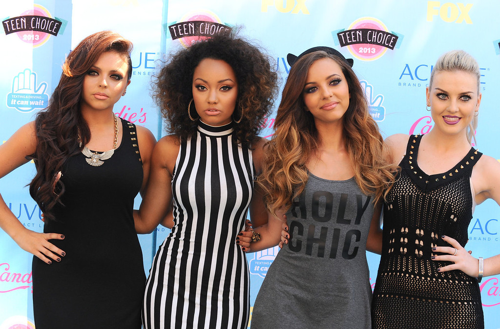 . Jesy Nelson, from left, Leigh-Anne Pinnock, Jade Thirwall and Perrie Edwards of the musical group Little Mix arrive at the Teen Choice Awards at the Gibson Amphitheater on Sunday, Aug. 11, 2013, in Los Angeles.(Photo by Jordan Strauss/Invision/AP)