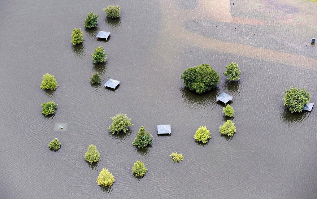 . Lake Lewisville floods a park, Friday, May 29, 2015 in The Colony, Texas. Floodwaters submerged Texas highways and threatened more homes Friday after another round of heavy rain added to the damage inflicted by storms. (AP Photo/Brandon Wade)