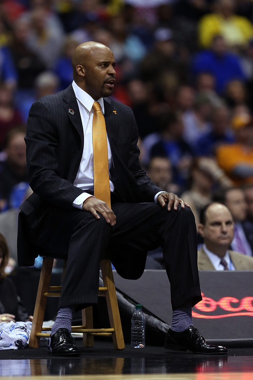 . Head coach Cuonzo Martin of the Tennessee Volunteers looks on against the Michigan Wolverines during the regional semifinal of the 2014 NCAA Men\'s Basketball Tournament at Lucas Oil Stadium on March 28, 2014 in Indianapolis, Indiana.  (Photo by Jonathan Daniel/Getty Images)