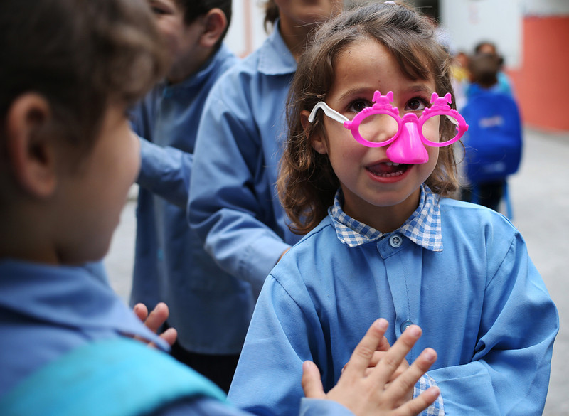 . In this picture taken on Thursday, May 29, 2014, Syrian refugee students play during a recess at a Lebanese public school where only Syrian students attend classes in the afternoon, in Kaitaa village in north Lebanon. (AP Photo/Hussein Malla)