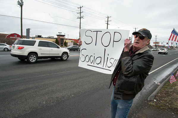 04/15/19 Wesley Bunnell | Staff Local TEA Party members protested taxes on Queen St. in Southington on April 15th which is the federal deadline for filing taxes. Joe Lambe, from Waterbury, holds a Stop Socialism sign at passing motorists.