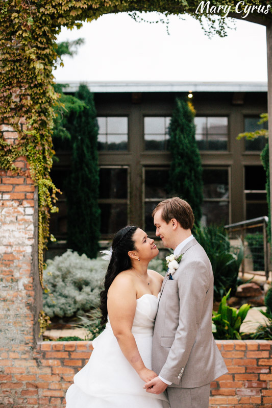 Larissa & Matt, the bride and groom, after their McKinney Cotton Mill wedding ceremony | Photo by Mary Cyrus Photography - Weddings & Portraits in Dallas & Beyond