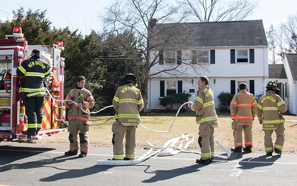 02/19/20 Wesley Bunnell | StaffrrNew Britain Fire responded to a kitchen fire at 223 Barbour St on Wednesday afternoon with a report of one person suffering from smoke inhalation. Firemen prepare to leave by rolling up hose.