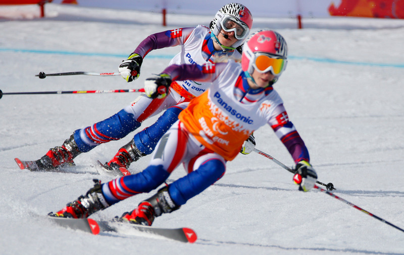 . Henrieta Farkasova of Slovakia, left, and her guide Natalia Subrtova race to win gold medal in the women\'s downhill, visually impaired event at the 2014 Winter Paralympic, Saturday, March 8, 2014, in Krasnaya Polyana, Russia. (AP Photo/Dmitry Lovetsky)