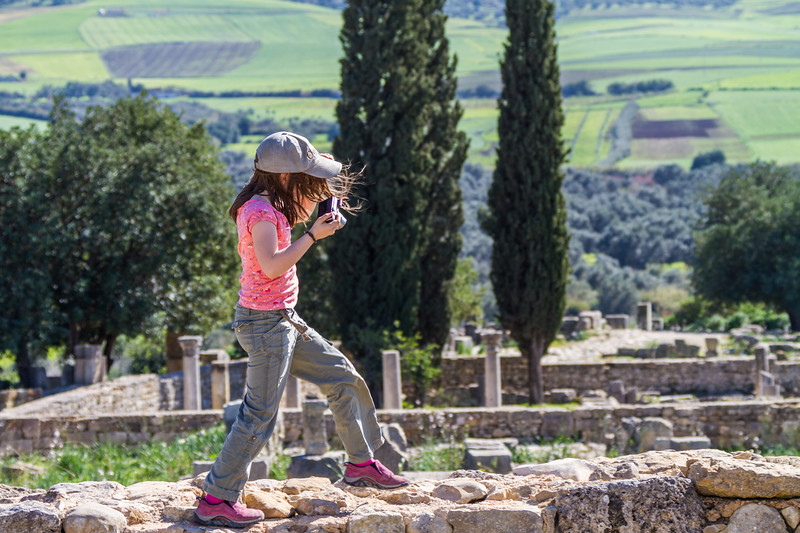Girl walking on stone wall at Ruins of Volubilis - Morocco - Volubilis