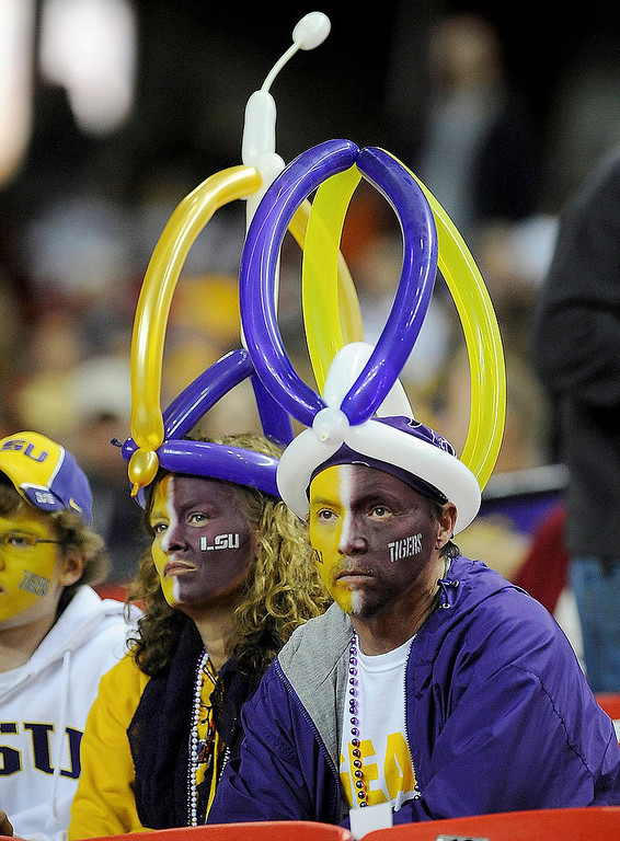 . LSU fans wait for the Chick-fil-A Bowl NCAA college football game between Clemson and LSU, Monday, Dec. 31, 2012, in Atlanta. (AP Photo/Mike Stewart)