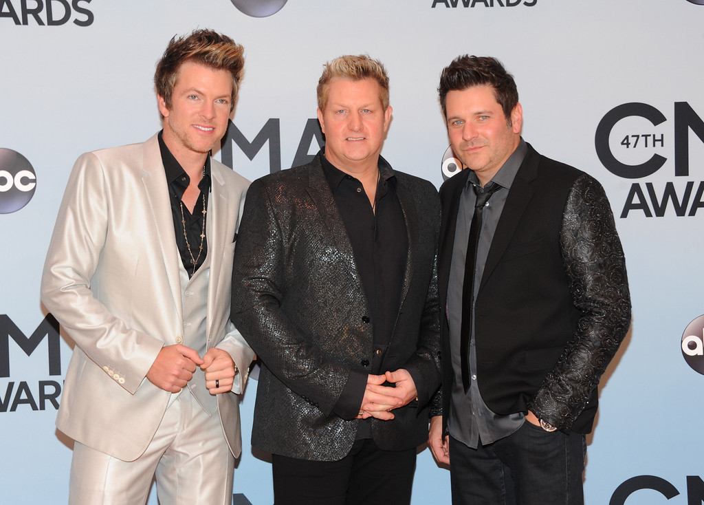 . Rascal Flatts, from left, Joe Don Rooney, Gary LeVox, and Jay DeMarcus arrive at the 47th annual CMA Awards at Bridgestone Arena on Wednesday, Nov. 6, 2013, in Nashville, Tenn. (Photo by Evan Agostini/Invision/AP)