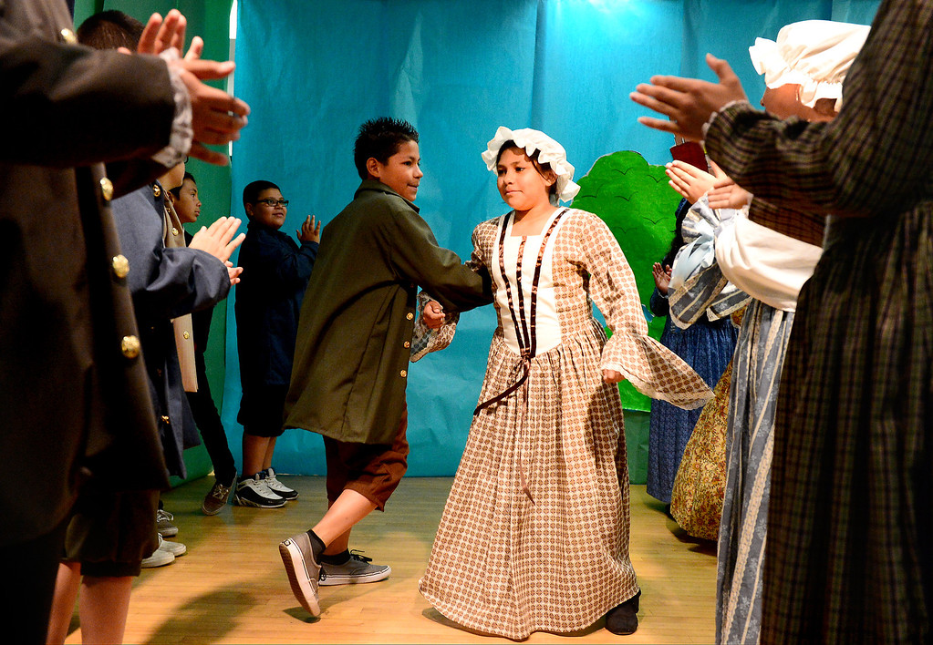 . Tracy Elementary School fifth-graders do the Virginia Reel during a Colonial Festival Tuesday morning, March 26, 2013 at the Baldwin Park school. In one month the students completed a report, learned two songs and two dances. Grecia Herrera, the school\'s nutritional aid, made the dresses and boys\' suits. (SGVN/Staff Photo by Sarah Reingewirtz)