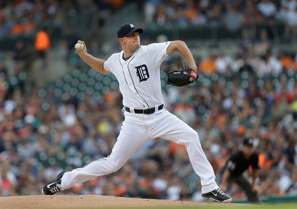 . Detroit Tigers pitcher Max Scherzer throws against the Kansas City Royals in the first inning of a baseball game in Detroit, Tuesday, June 17, 2014.  (AP Photo/Paul Sancya)