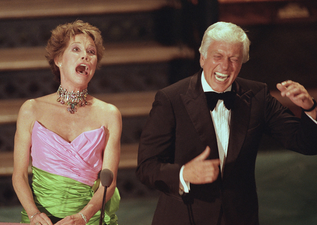 . Dick Van Dyke breaks up as Mary Tyler Moore yells �Oooooh Rob,� something she used to do during their years together on �The Dick Van Dyke� show, at the 40th annual Emmy awards in Pasadena, Calif., Aug. 29, 1988. (AP Photo/Reed Saxon)