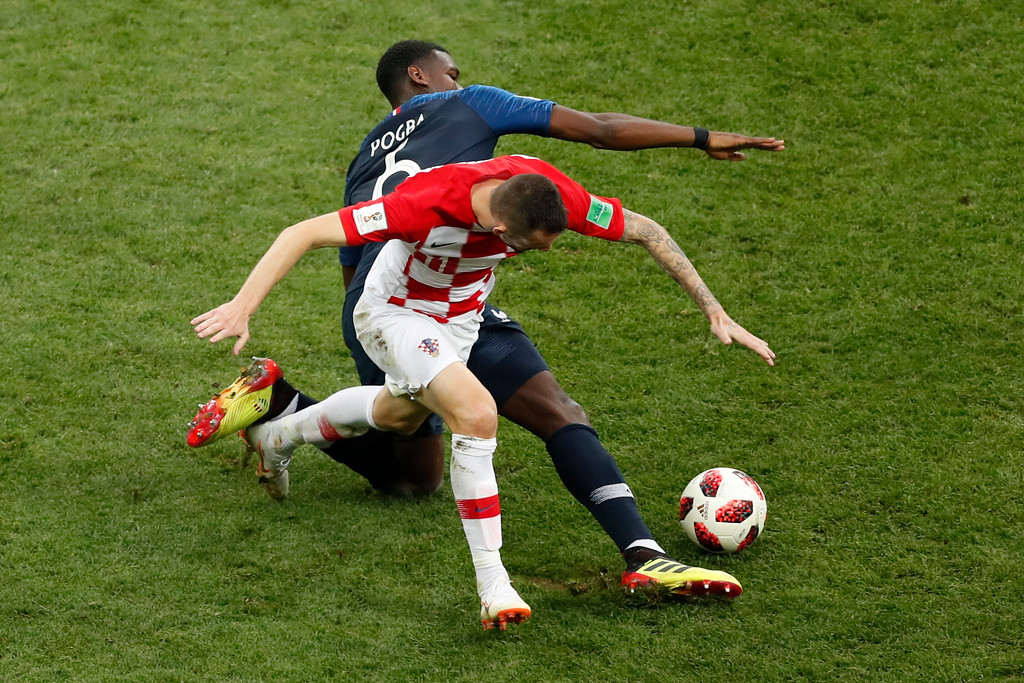 . France\'s Paul Pogba, top, and Croatia\'s Marcelo Brozovic challenge for the ball during the final match between France and Croatia at the 2018 soccer World Cup in the Luzhniki Stadium in Moscow, Russia, Sunday, July 15, 2018. (AP Photo/Rebecca Blackwell)