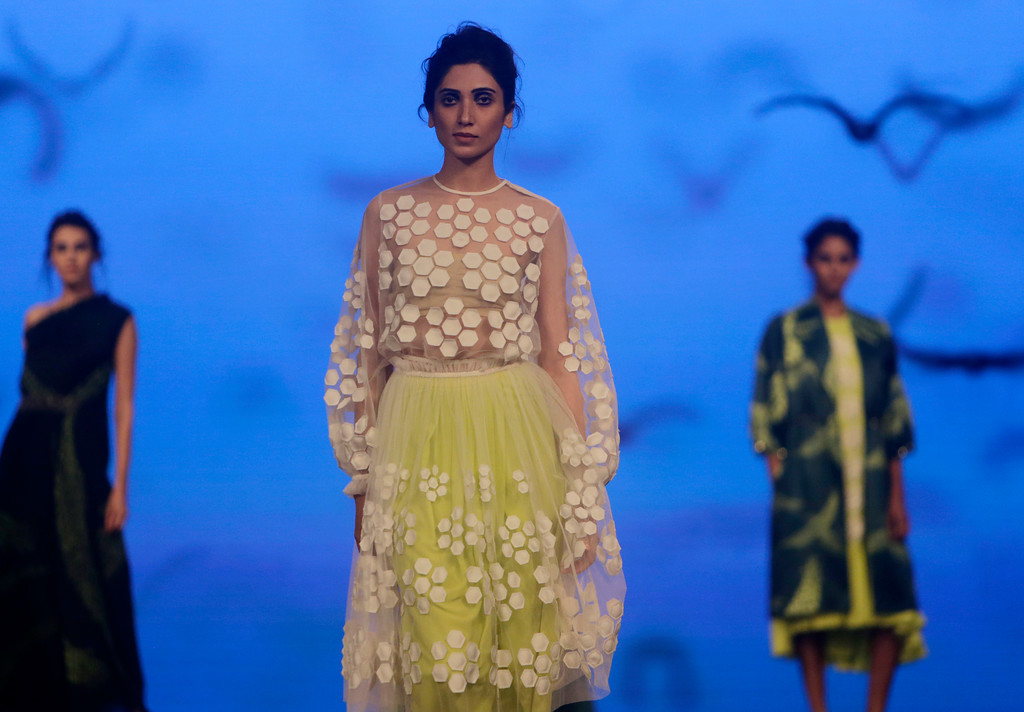 . Models walk the ramp to showcase the creation of designer Urvashi Joneja during the Lakme fashion week winter in Mumbai, India, Wednesday, Aug. 22, 2018. (AP Photo/Rajanish Kakade)