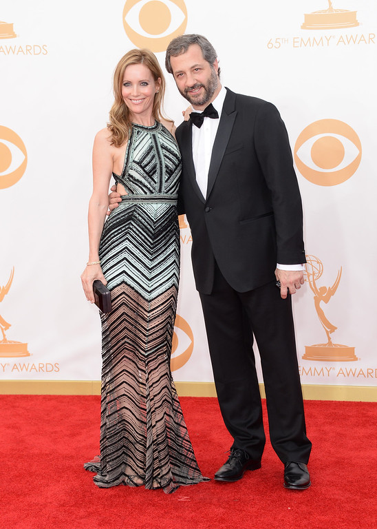 . Actress Leslie Mann (L) and husbnd Director Judd Apatow arrive at the 65th Annual Primetime Emmy Awards held at Nokia Theatre L.A. Live on September 22, 2013 in Los Angeles, California.  (Photo by Jason Merritt/Getty Images)