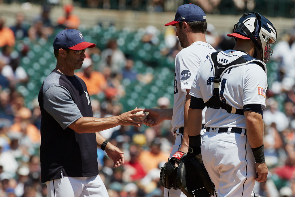 . Detroit Tigers manager Brad Ausmus, left, takes the ball to relieve starting pitcher Justin Verlander, center, in the fourth inning of a baseball game against the Cleveland Indians in Detroit, Sunday, July 2, 2017. (AP Photo/Rick Osentoski)