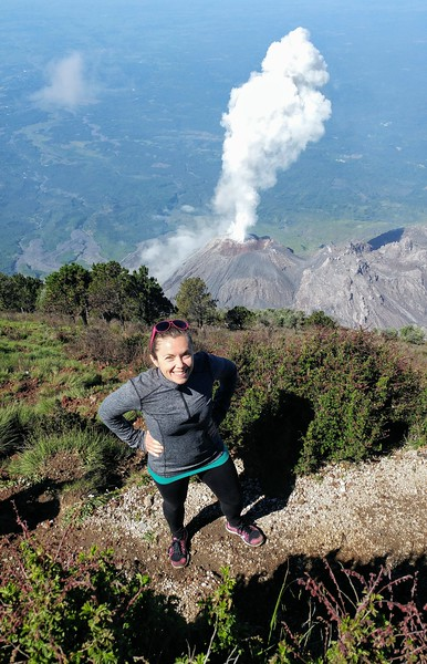 woman posing in front of active volcano