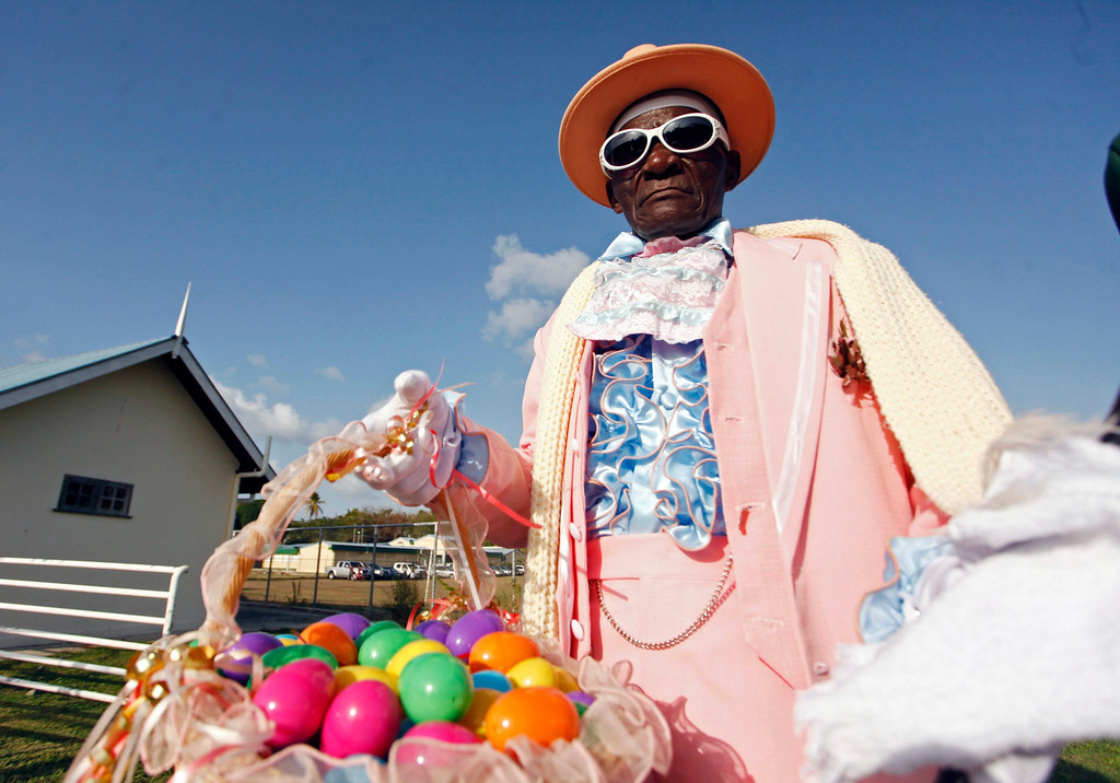 . A man carries a basket full of Easter eggs to distribute to children at the annual Buccoo Goat and Crab Race Festival at Buccoo Integrated Facility on Tobago Island, April  2, 2013. The event is part of the island\'s annual Easter celebration. Picture taken April 2, 2013. REUTERS/Andrea De Silva