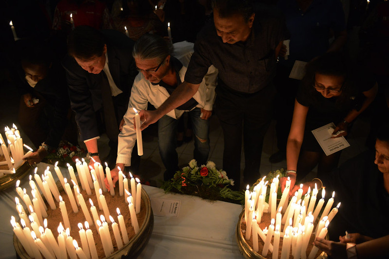 . Family and friends of the victims of the Westgate Mall attack attend a candle vigil marking the first anniversary of the Westgate attack at the Amani-Peace gardens in Nairobi September 21, 2014. Thousands of mourners gathered in Kenya\'s capital on Sunday for emotional commemorations marking a year since Somali Islamist gunmen attacked Nairobi\'s Westgate shopping mall and massacred at least 67 people.  SIMON MAINA/AFP/Getty Images